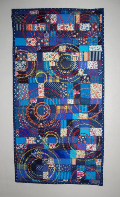 Billedtæppe med cirkler og pyntesømme