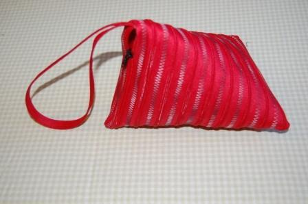 Rød og meleret bolchetaske